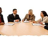 Group of happy business people in a meeting