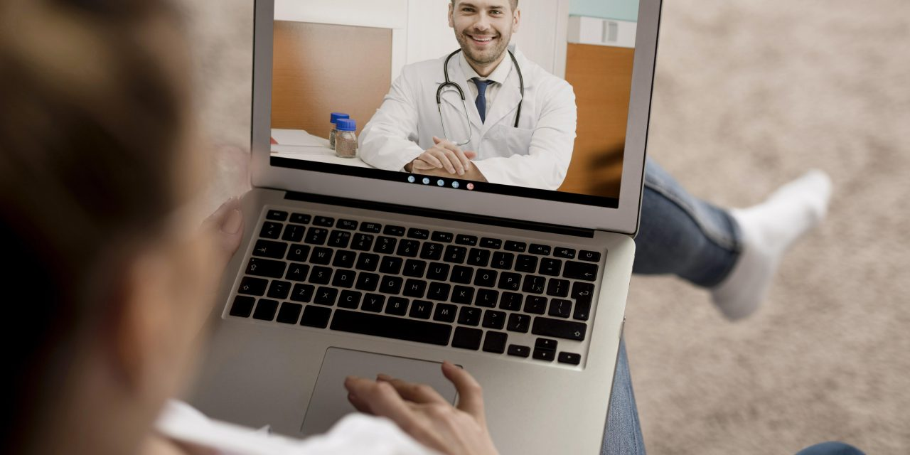 https://www.absolute-interpreting.co.uk/wp-content/uploads/2020/07/high-angle-video-call-on-laptop-with-doctor-1280x640.jpg
