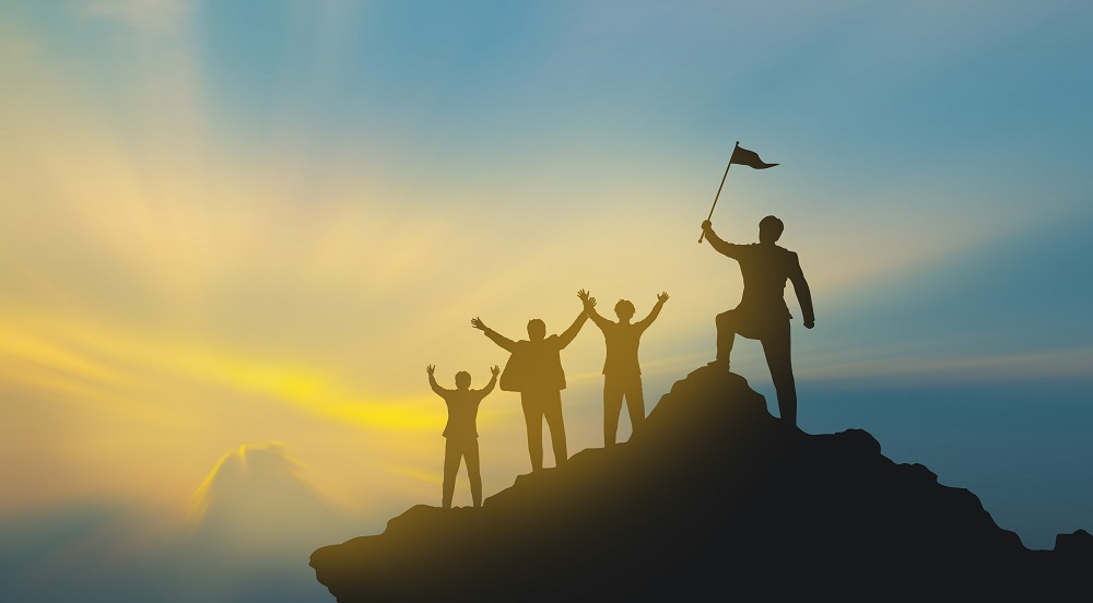 https://www.absolute-interpreting.co.uk/wp-content/uploads/2020/09/group-of-people-on-mountains-top-in-winner-pose-teamwork-concept_small.jpg