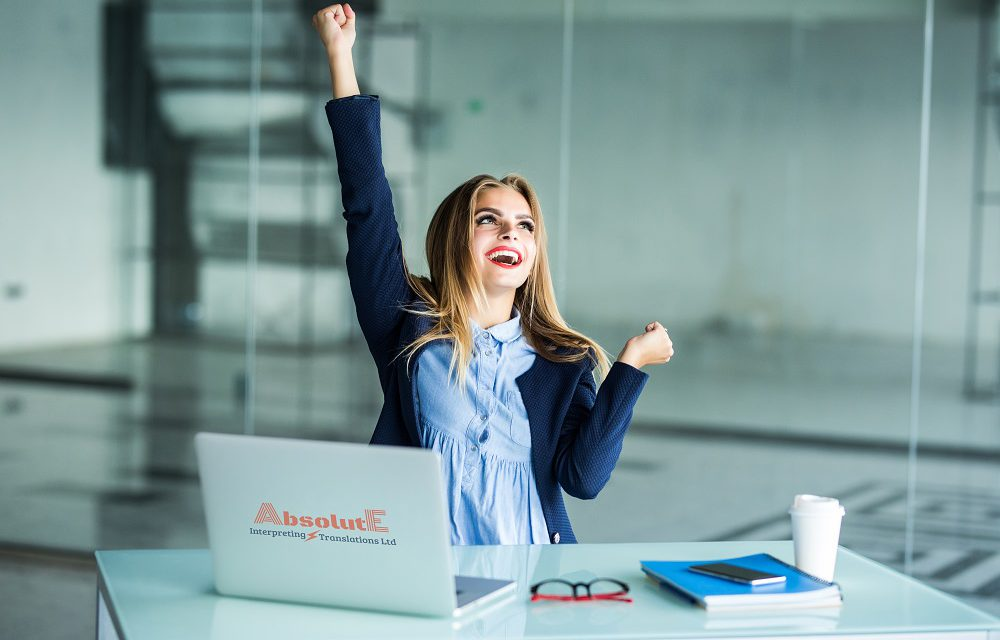 https://www.absolute-interpreting.co.uk/wp-content/uploads/2020/09/successful-young-business-woman-with-arms-up-at-the-office_small-1000x640.jpg