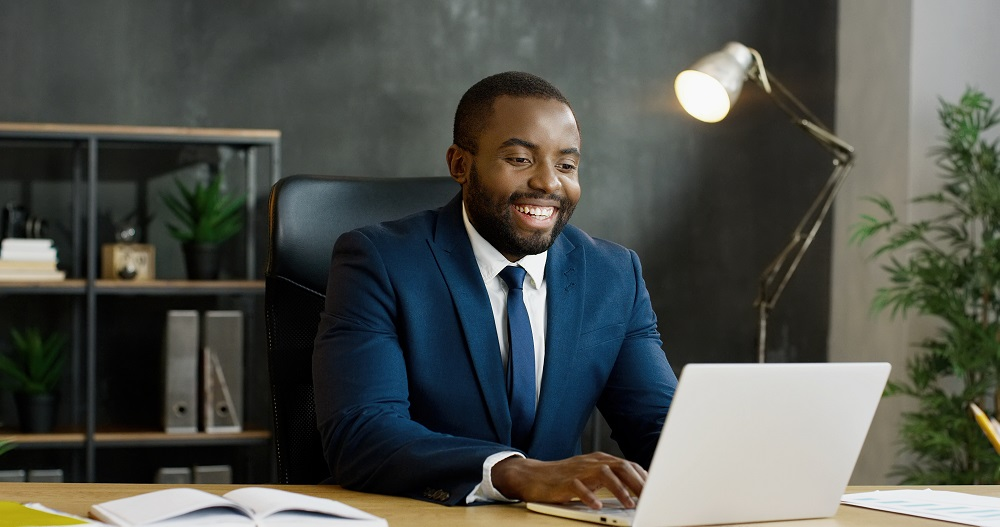 https://www.absolute-interpreting.co.uk/wp-content/uploads/2021/02/african-american-businessman-sitting-table-having-videochat-laptop-computer_small.jpg